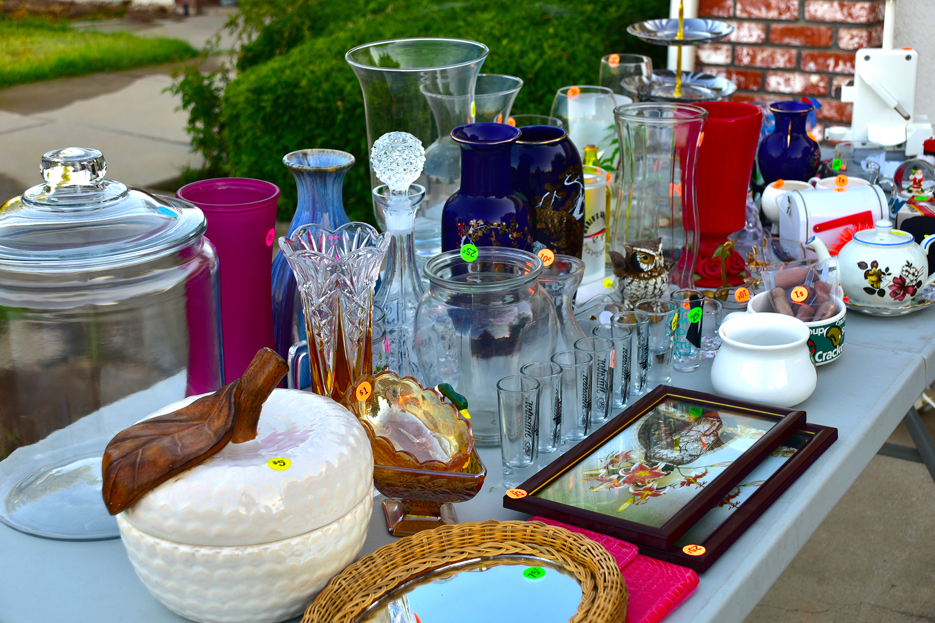 Garage sale with items priced and displayed on a table