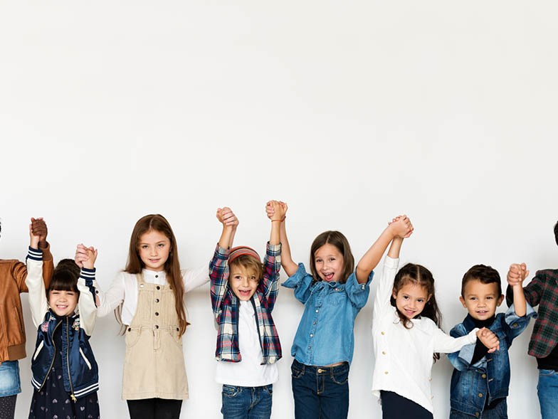 children holding up arms