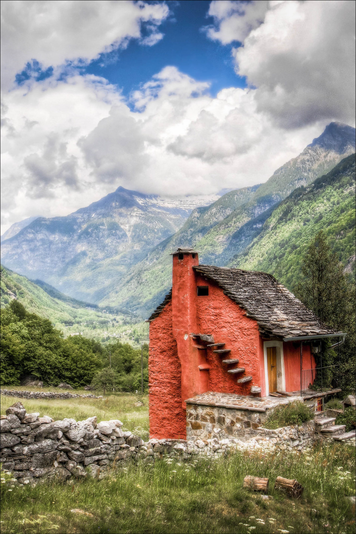 Red tiny home nesteled within mountain region