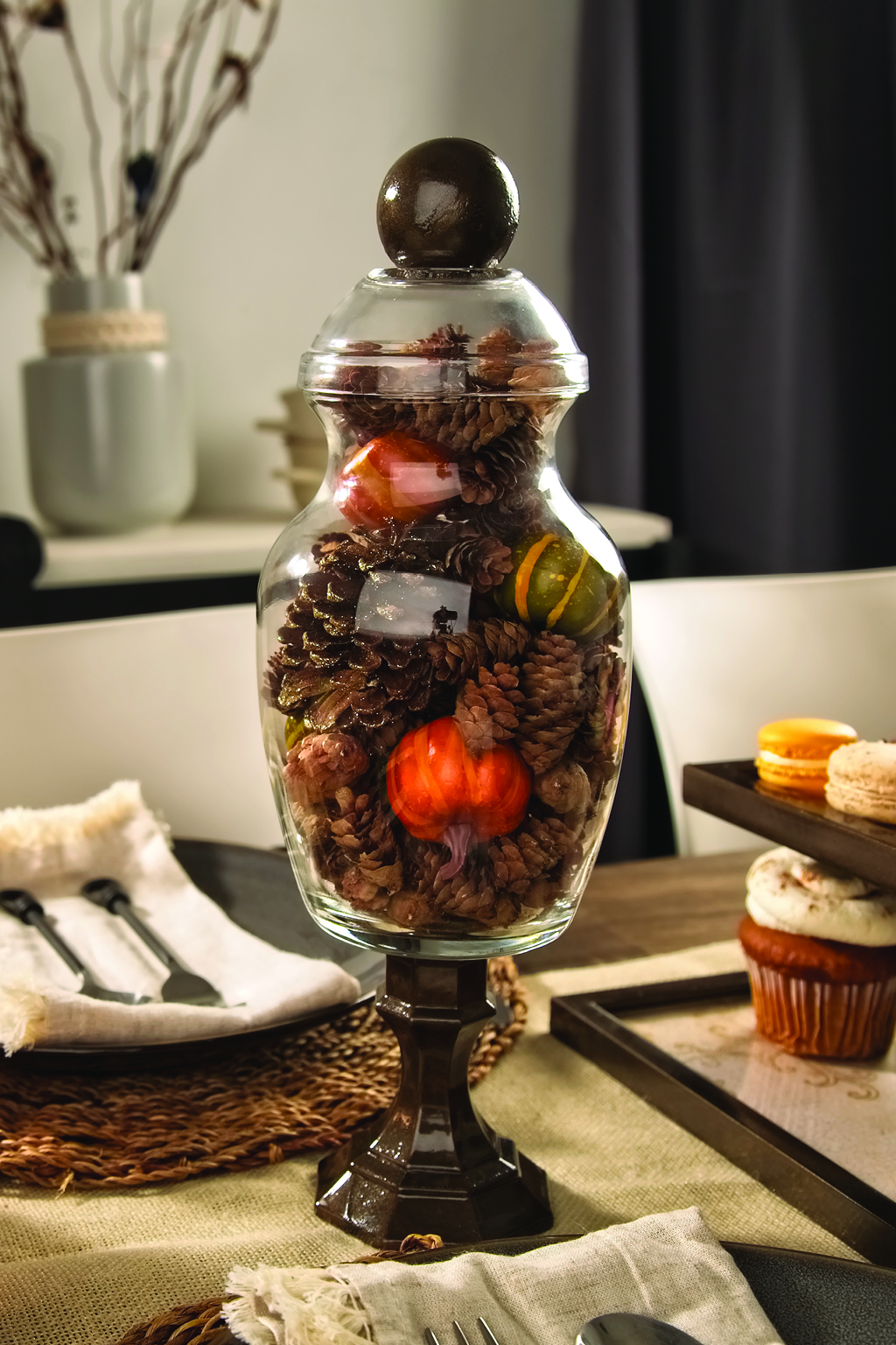 Glass apothecary jar filled with fall accents
