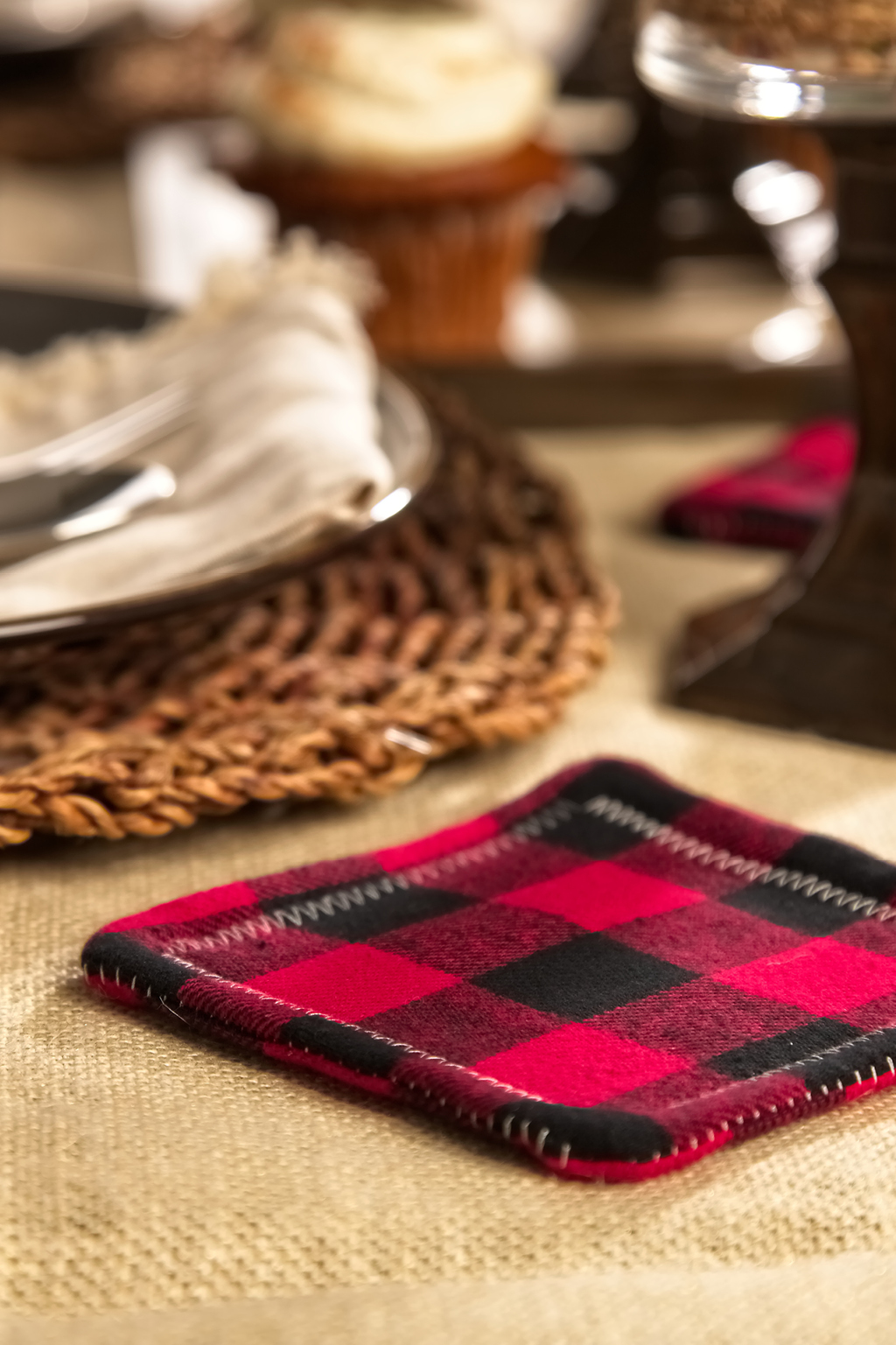 Red and black flannel coaster on table
