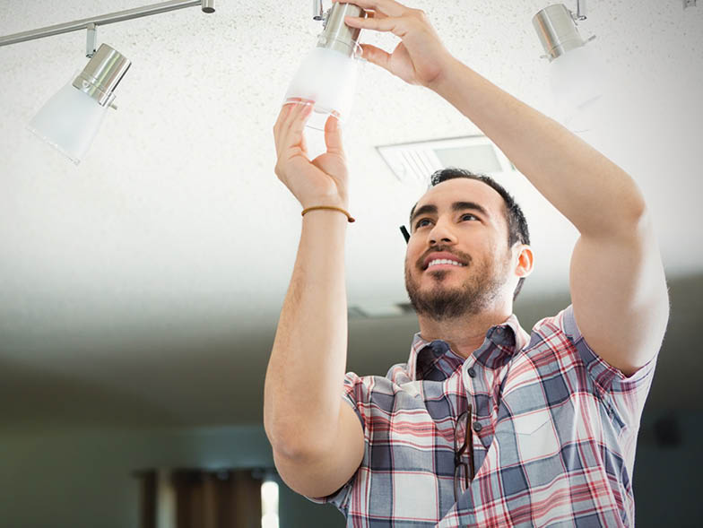 guy inserting light to fixture
