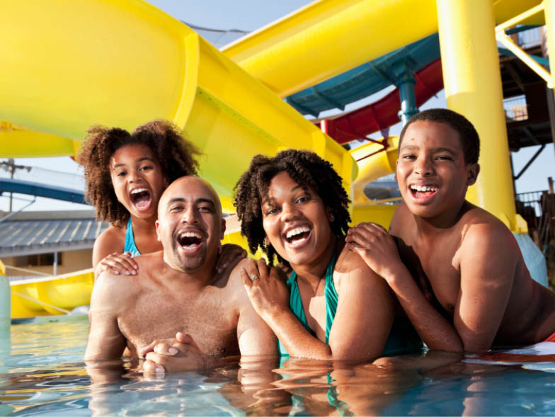 Family in pool at waterpark