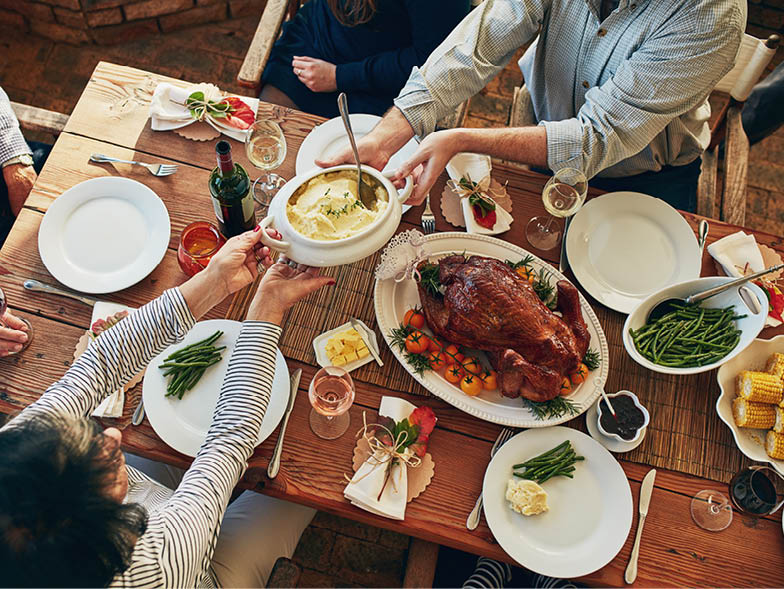 Holiday foods being passed around a table