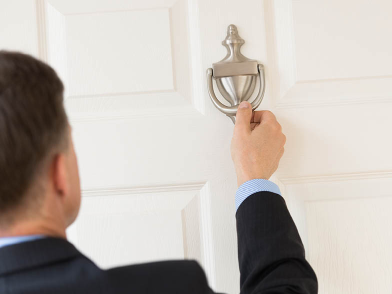 Man knocking on door