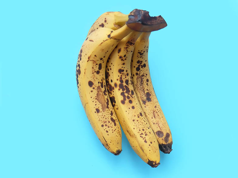 Ripe bananas on a blue background