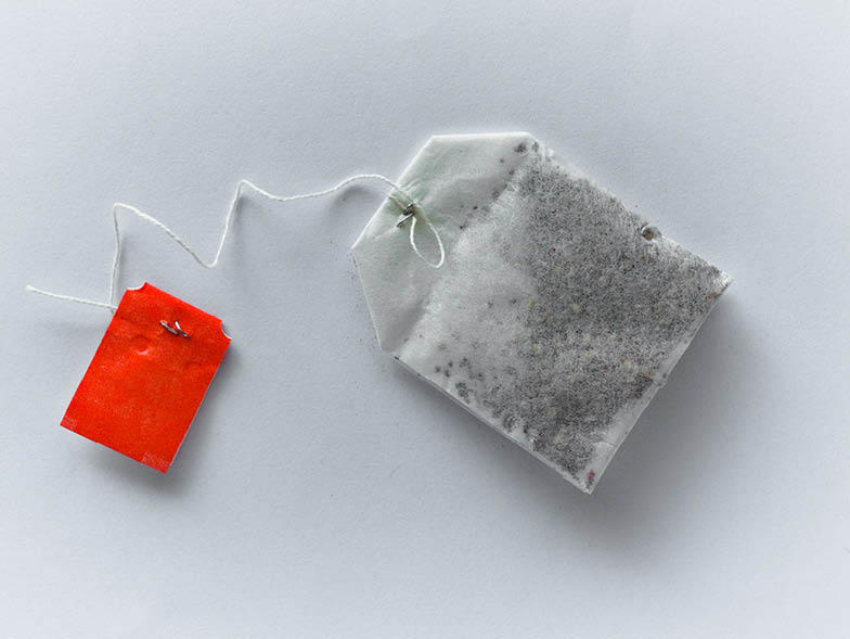 Teabag laying on gray surface