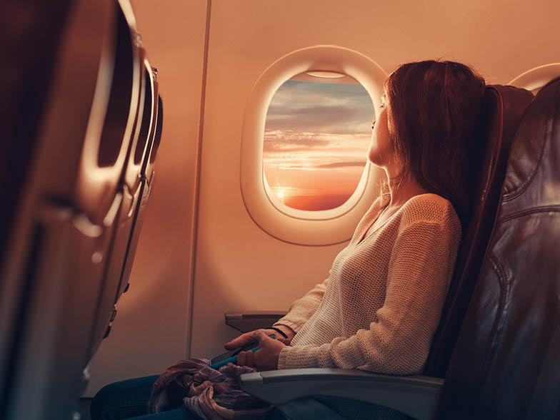 Woman looking out window on plane
