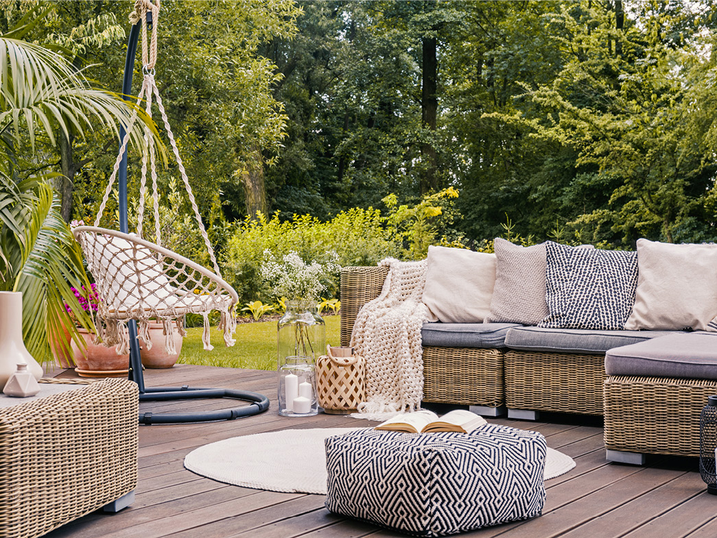 Patio decorated with pillows, sofas, and rug
