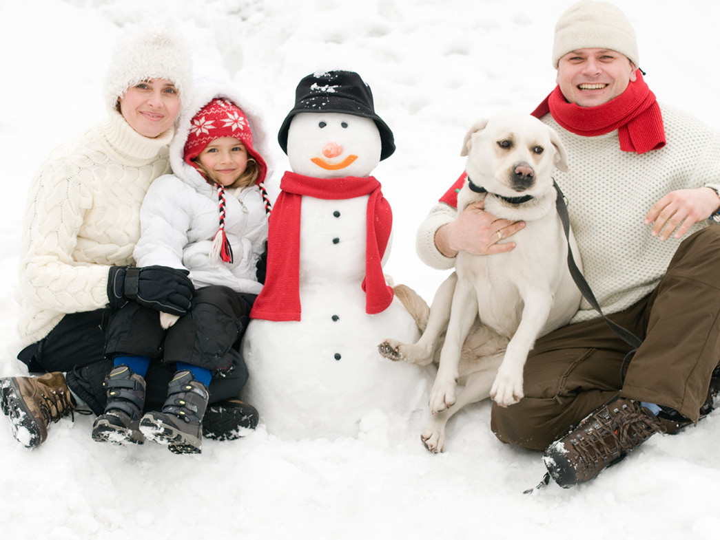 Family outside with dog