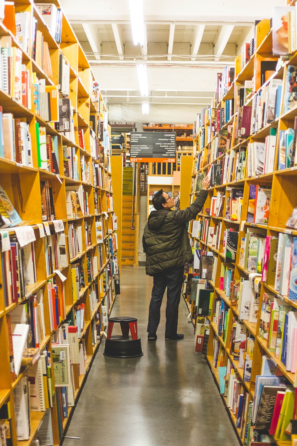 man browsing an aisle of books