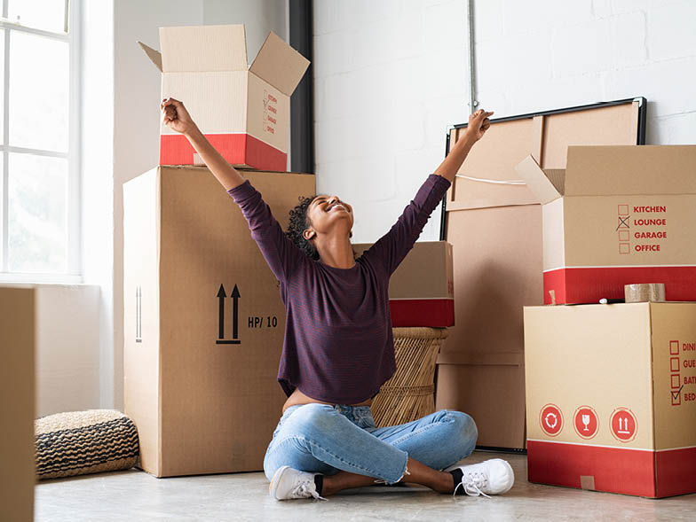 woman sitting around moving boxes
