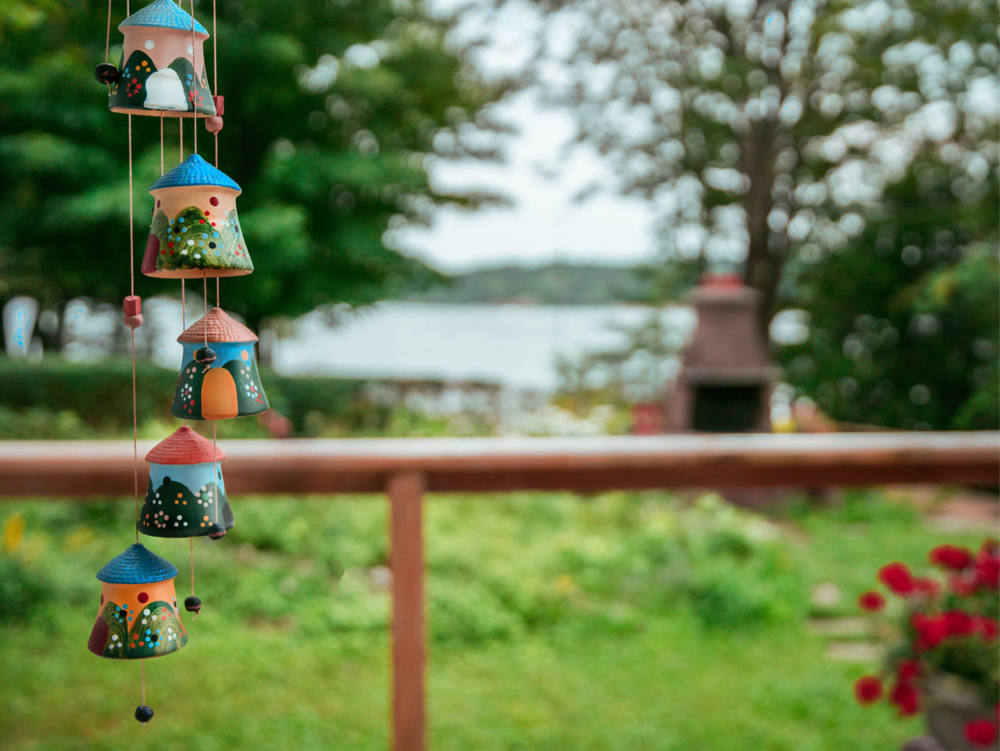 view of lake from house with windchime
