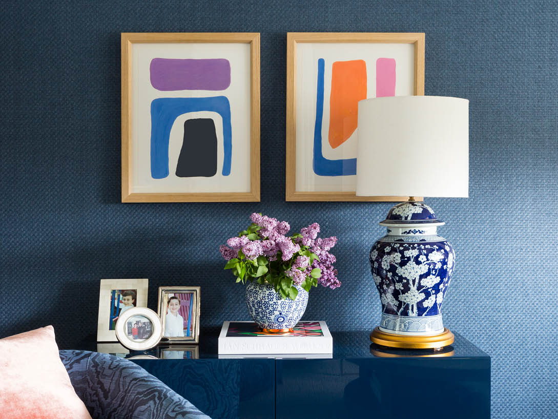 blue wall with art and white and blue lamp